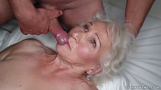 Granny Norma cheats on her sleeping husband with young timber