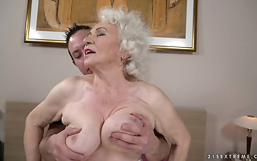 Squeezing the tits of granny Norma measurement drilling her pussy